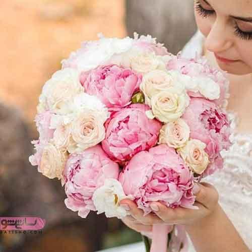 دسته گل پاییزی عروس با گلهای صورتی و نارنجی