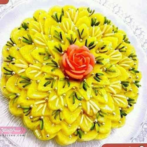 تزیین شله زرد قالبی به شکل گل رز