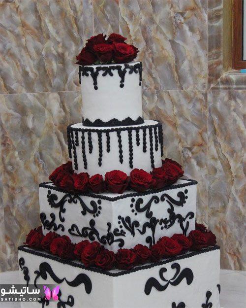 کیک تولد مربعی چند طبقه تزیین شده با گل طبیعی