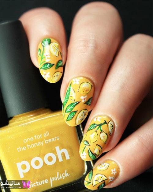عکس طراحی زیبا روی ناخن زرد